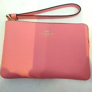 Coach pink wristlet Brand New with tag!!